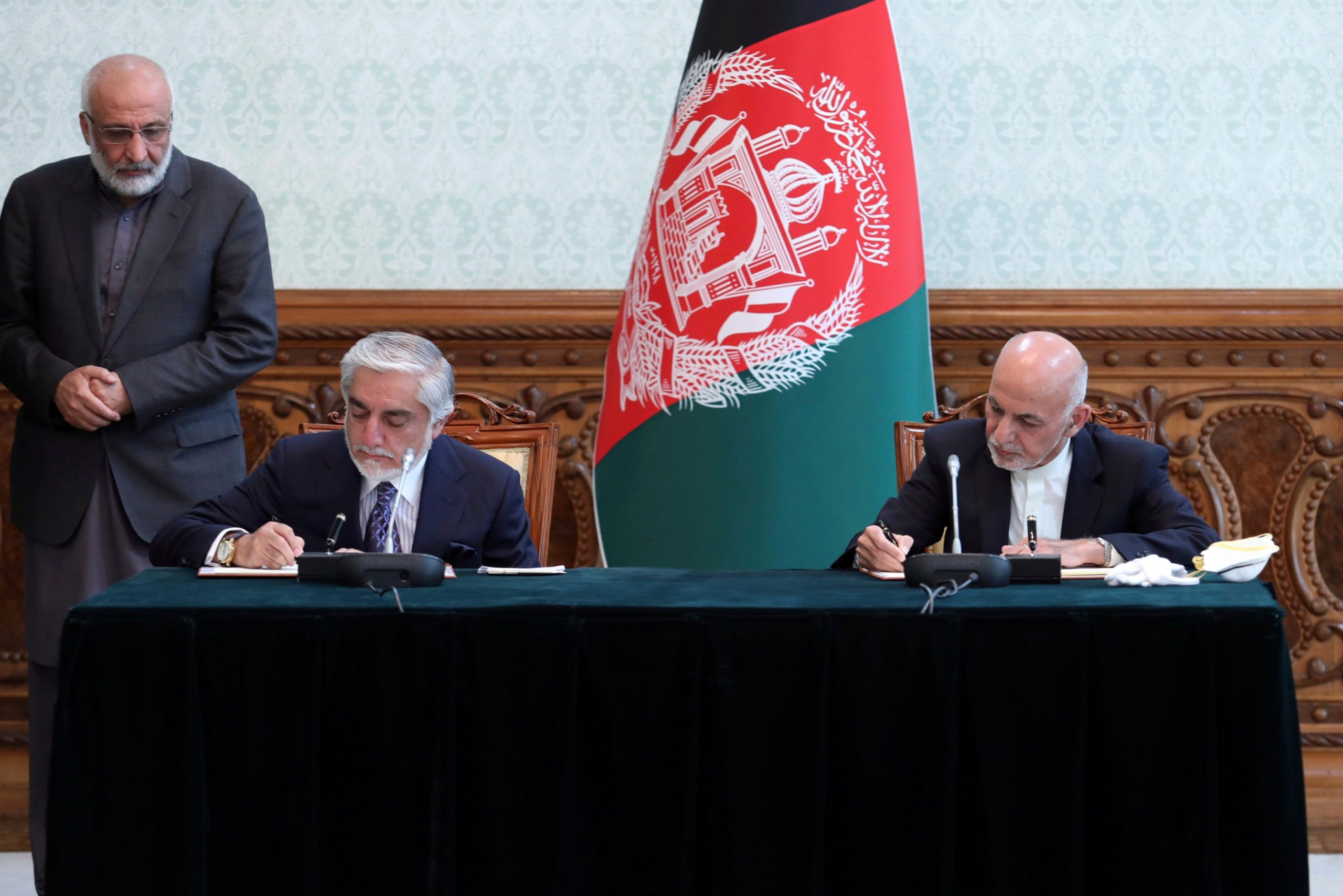 The deal, signed by both, states Ghani would remain president and calls for Abdullah to lead the country's National Reconciliation High Council.